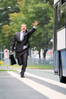 late_businessman_running_after_bus