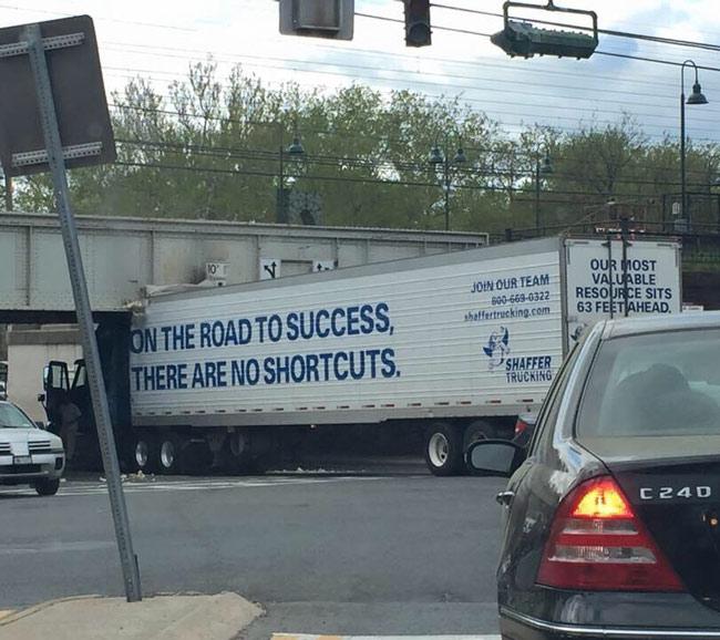 truck-stuck-under-bridge