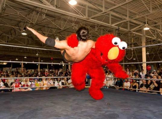 elmo-wrestling-slam-tickle-this-muppet-13753090180